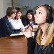 Beautiful business woman with headset — Stock Photo