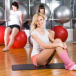 Girl in fitness center — Stock Photo