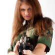 Pretty woman with a gun — Stock Photo #5966565