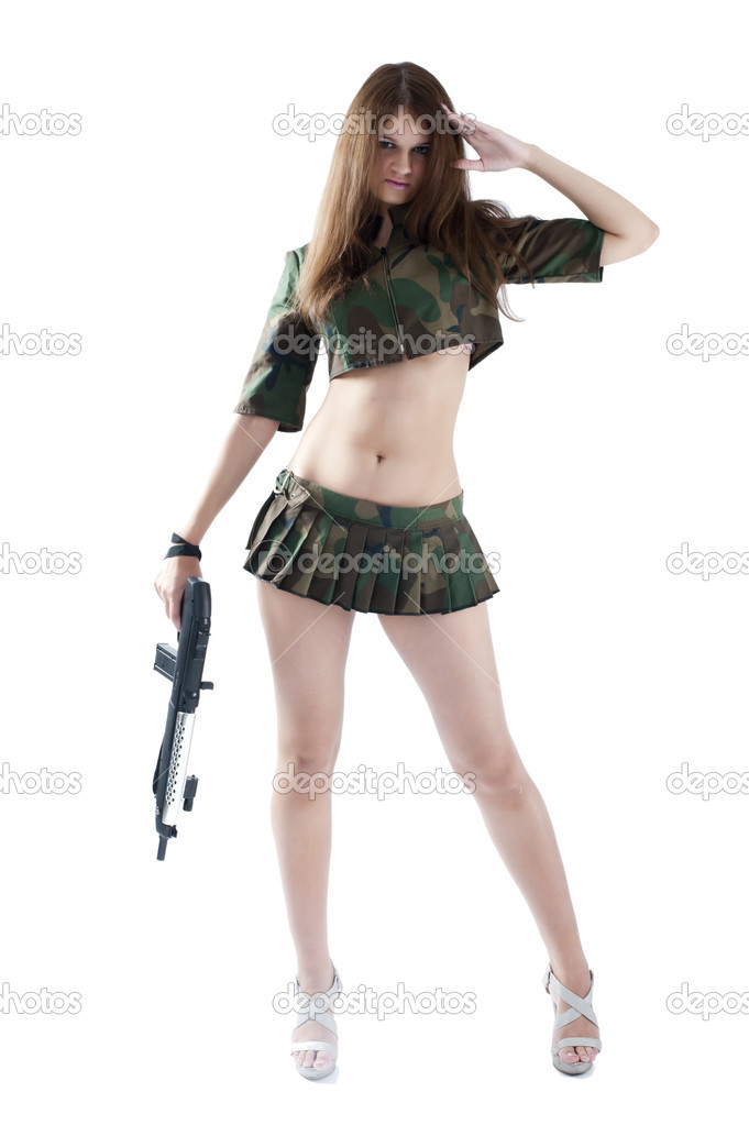 Sexy young woman with a gun isolated on white — Stock Photo #5974698