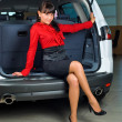 Stock Photo: Womin luggage compartment