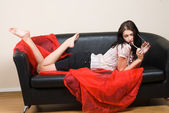 Woman on sofa — Stock Photo