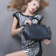 Stock Photo: Sexy fashionable womwith bag