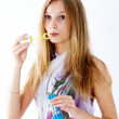 Attractive girl with soap bubbles — Stock Photo