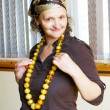 Woman with amber beads — Stock Photo #6166315