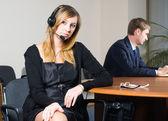 Beautiful business woman with headset — Stock Photo