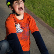 Funny boy on the bike with helmet — Stock Photo #5620923