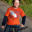 Funny boy on the bike with helmet — Stock Photo
