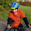 Funny boy on the bike with helmet — Stock Photo #5620956
