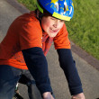 Funny boy on the bike with helmet — Stock Photo #5620980