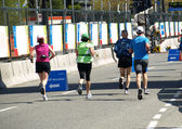 Group of athletes of all ages are running a marathon — ストック写真