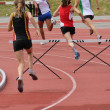 Stock Photo: Girls running 200 meter hurdles