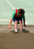Boy on the long jump — Stock Photo
