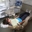 Stock Photo: Boy at dentists clinic