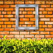White picture frame on Brick wall — Stock Photo #5988943