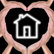 Stock Photo: House icon in hands created heart