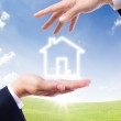 House icon on hand — Stock Photo