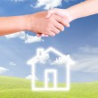 Hand shaking and house icon — Stock Photo #6182224