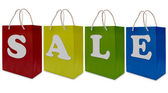 Sale label on shopping paper bag — Stock Photo