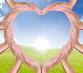 Hands heart on new day — Stock Photo