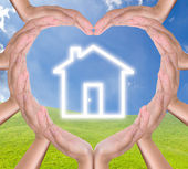 House icon in hands heart — Stock Photo