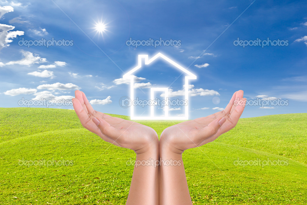 House icon on hand and meadow — Stock Photo #6182286