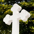 White modern cross isolated on tree background — Stock Photo