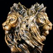 Stock Photo: Two faces of lion statue