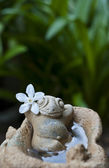 Ceramic frog in relaxing action — Stock Photo