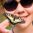 Girl with butterfly — Stock Photo