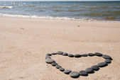 Heart from stones on beach — Stock Photo