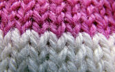 Knitted lilac and white thread product — Stock Photo