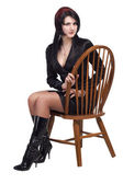 Woman sitting on vintage chair — Stock Photo