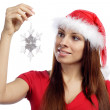Sexy girl in red dress hold snowflake — Stock Photo