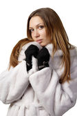 Stunning sexy young woman in fur coat — Stock Photo