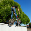 Boy jumping from wall on bmx — Stock Photo