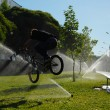 Boy jumping over fountain on bmx — Stock Photo #6024787