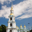 Stock Photo: Nicholas Naval Cathedral in background of blue sky with clou