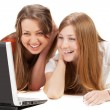 Two young happy student girl work on laptop — Stock Photo #5388155