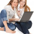 Two young happy student girl work on laptop — Stock Photo #5388441