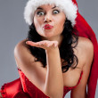 Beautiful christmas woman in santa hat - Stock Photo