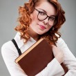 Young woman in glasses with a book — Stock Photo