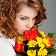 Woman with a bouquet of flowers - Stock Photo