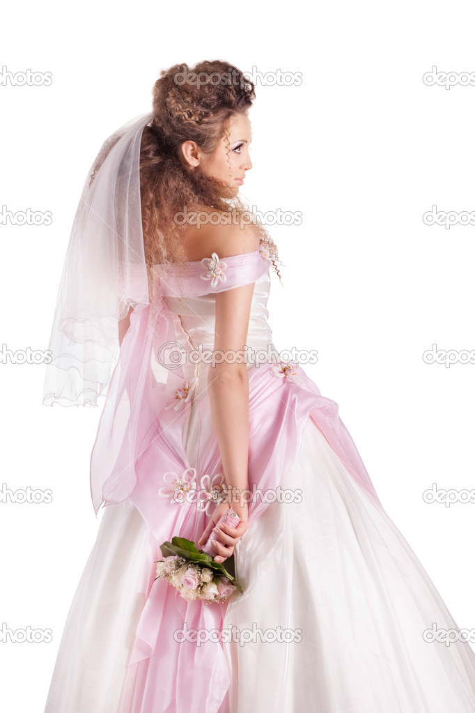 Beautiful woman dressed as a bride over white background  Stock Photo #5427347