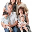 Studio Shot Of Family Group Sitting In Studio — Stockfoto