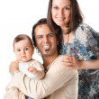 Casual portrait of a attractive young family - Stock Photo