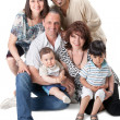 Studio Shot Of Family Group Sitting In Studio — Stock Photo