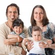 Casual portrait of a attractive young family — Stock Photo #5672008