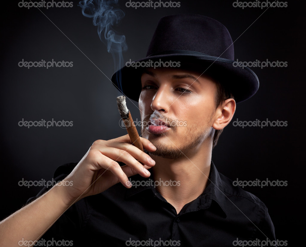 Hot Cigar Men http://depositphotos.com/5719655/stock-photo-Gangster-look.-Man-with-hat-and-cigar..html