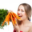 Attractive woman holds bunch of carrots — Stock Photo #6301039